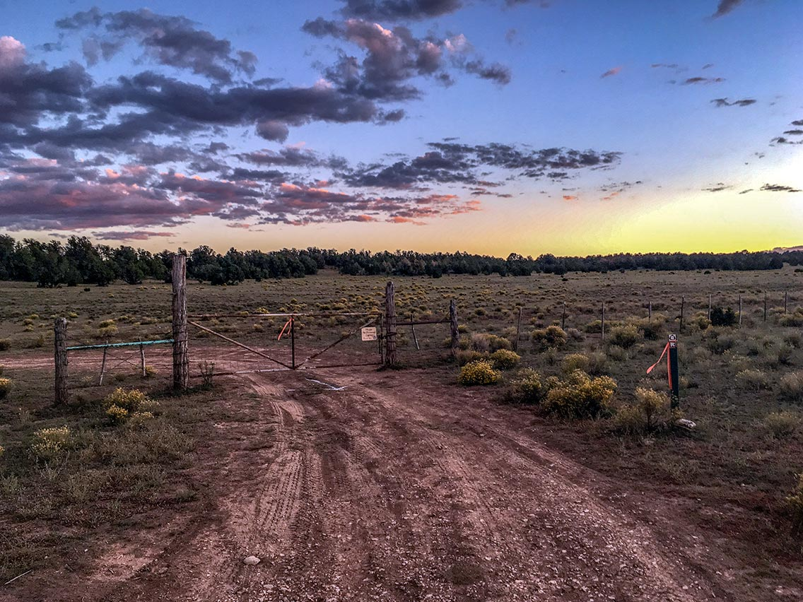 Sunset and livestock gate, Babbitt Ranch